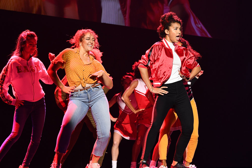 The Cast of High School Musical: The Musical: The Series performs at the Disney+ Sneak Peak at the 2019 D23 Expo.