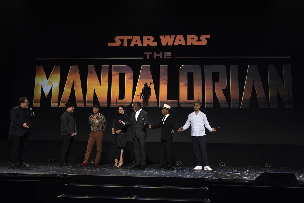 The cast and directors of the Mandalorian introduce the new series in the Disney+ Sneak Peak at the 2019 D23 Expo.
